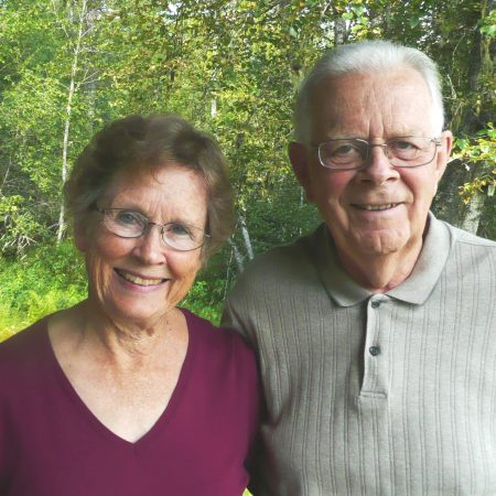 Dr. Robert Bond shares Priest Lake stories with his wife Georgene at their cabin on the end of Coolin Bay.